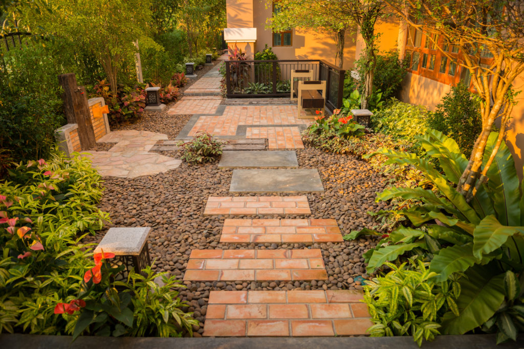 a beautiful garden with decorative gravel
